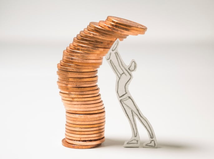 paper cut-out stick figure pushes stack of coins up