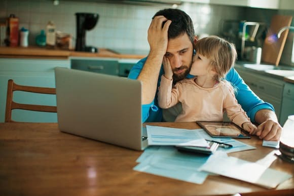 practical money skills, Father and daughter sitting in the kitchen