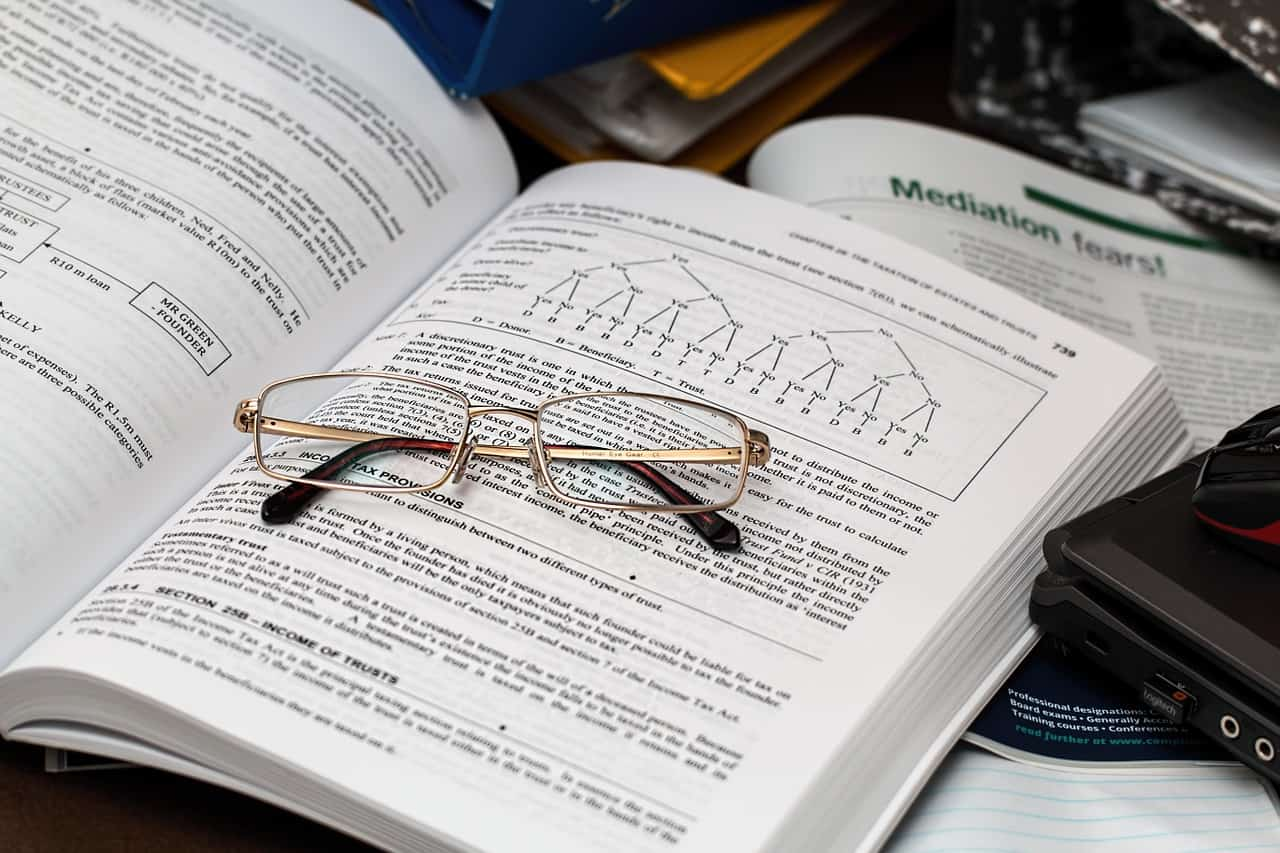 finance book with reading glasses